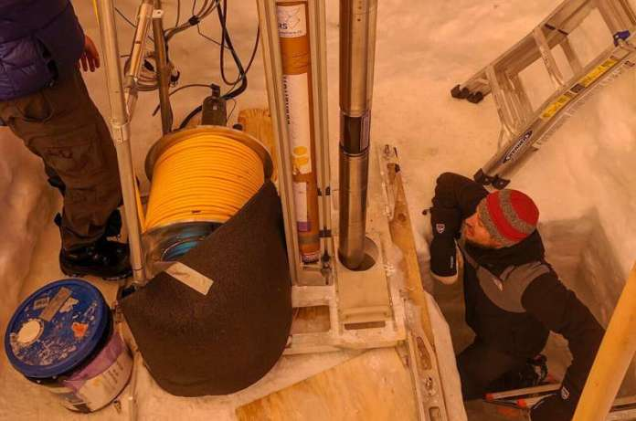 Probing for life in the icy crusts of ocean worlds