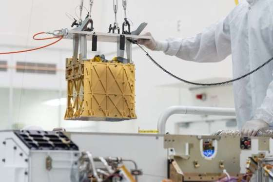 This documentary photo obtained on April 21, 2021 and published by NASA / JPL shows technicians in the clean room carefully lowering the M