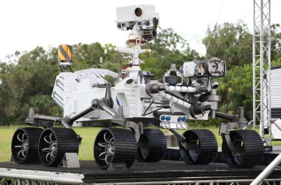 A close-up view of a full-size Perseverance rover model on display at Cape Canaveral Airport in Florida