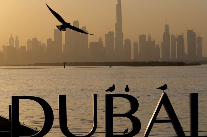 Dubai closes bars, limits activities after virus cases spike