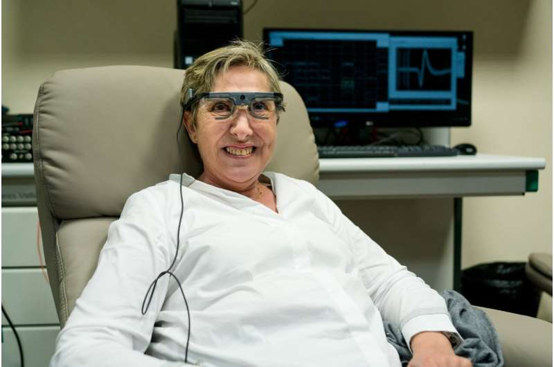 Researchers stimulate the vision of a blind person, allowing her to see simple shapes and letters