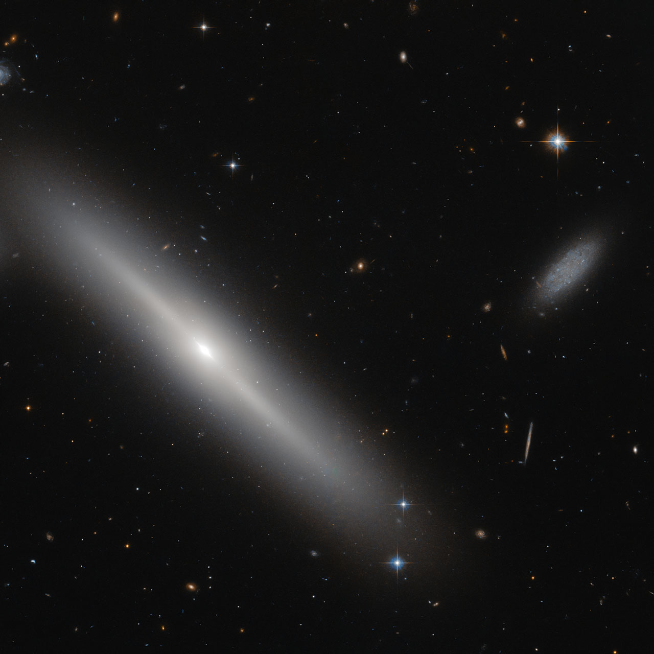 Hubble Sees A Swarm Of Ancient Star Clusters Around A Galaxy