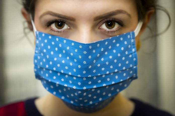 Wearing face masks at home might help ward off COVID-19 spread ...