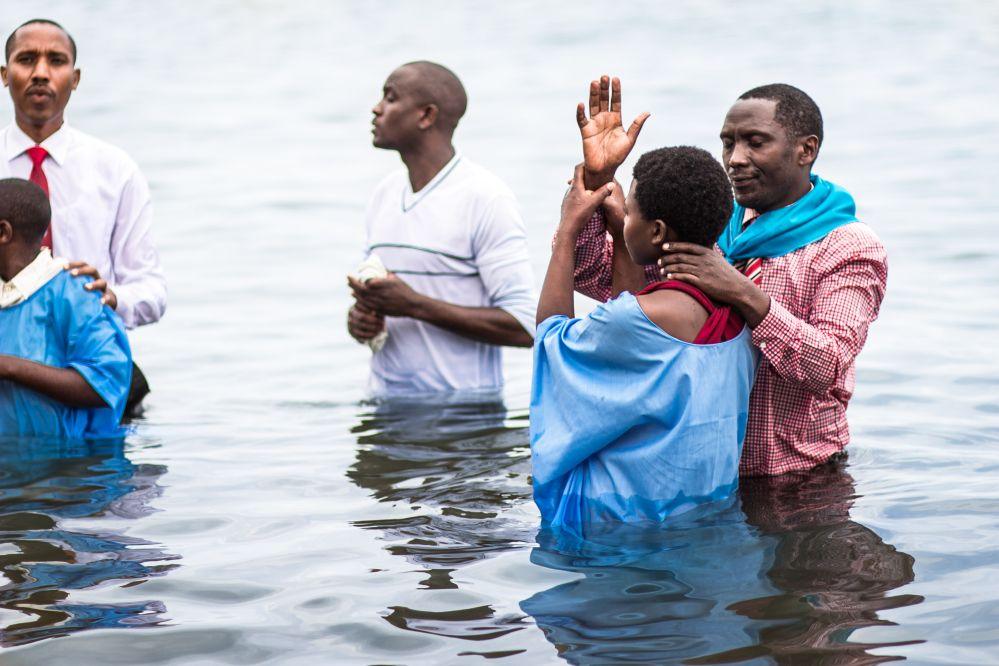 Some of the 100,777 people baptized in Rwanda after the evangelistic meetings.