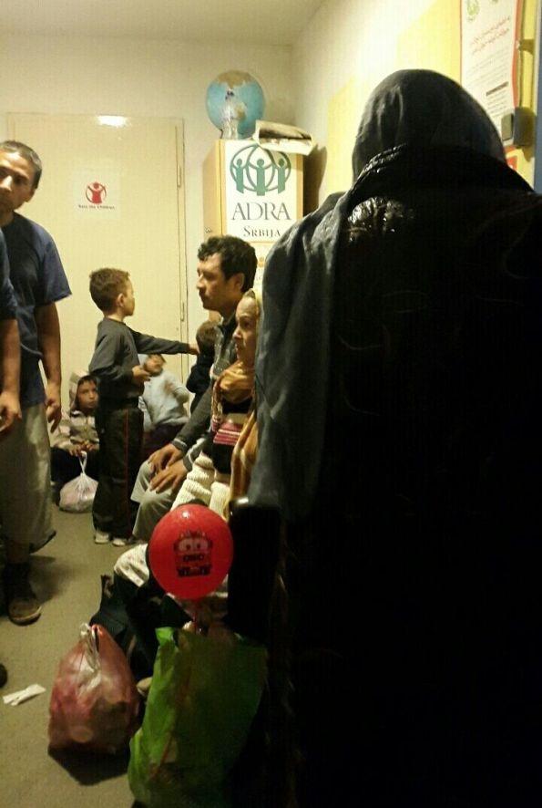 Refugee families receiving assistance on the upper floor of the refugee center in Belgrade. (Igor Mitrović)