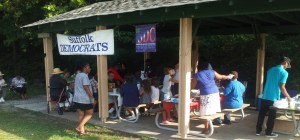 Members and guests gather at the picnic tables