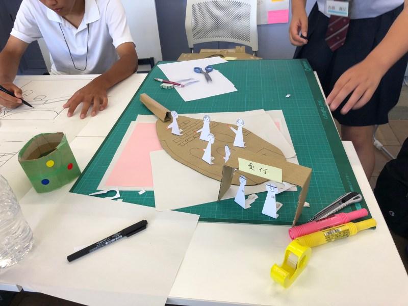Students creating a cardboard service prototype at Yokosuka high school.