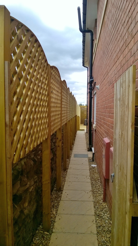 lattice fencing on slopping ground york 1
