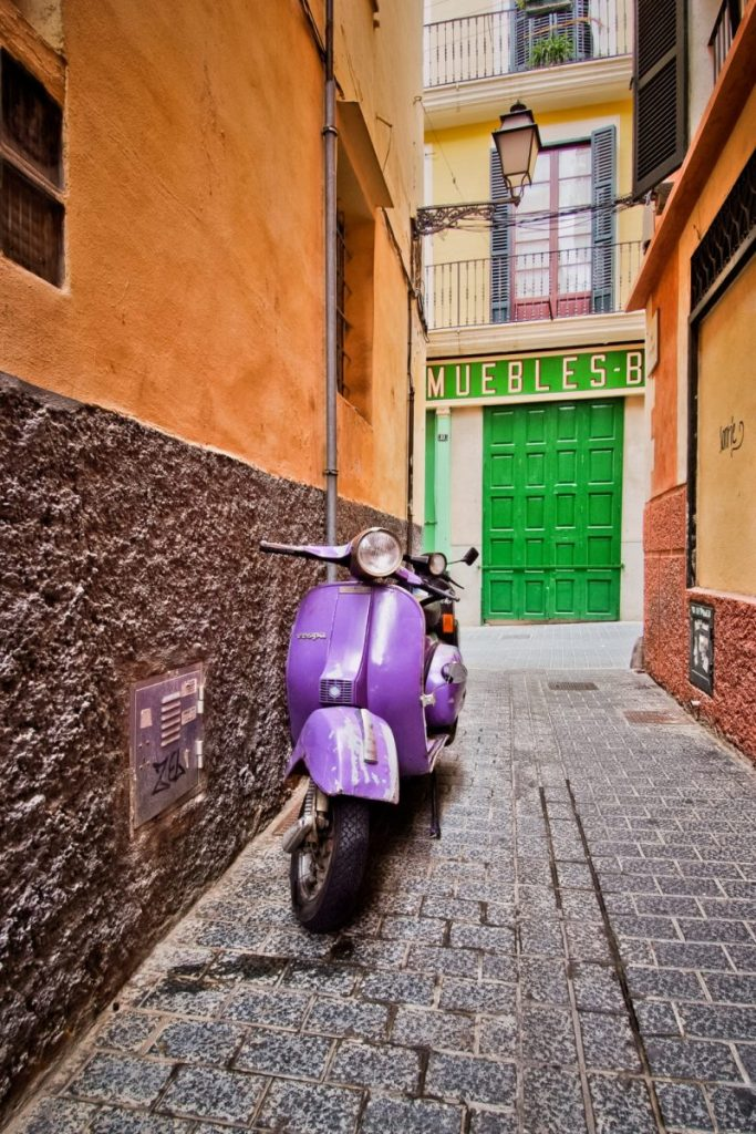"Honorable mention, Travel category: ""Purple Scooter and Green Door"" by Alexander S. Kunz"
