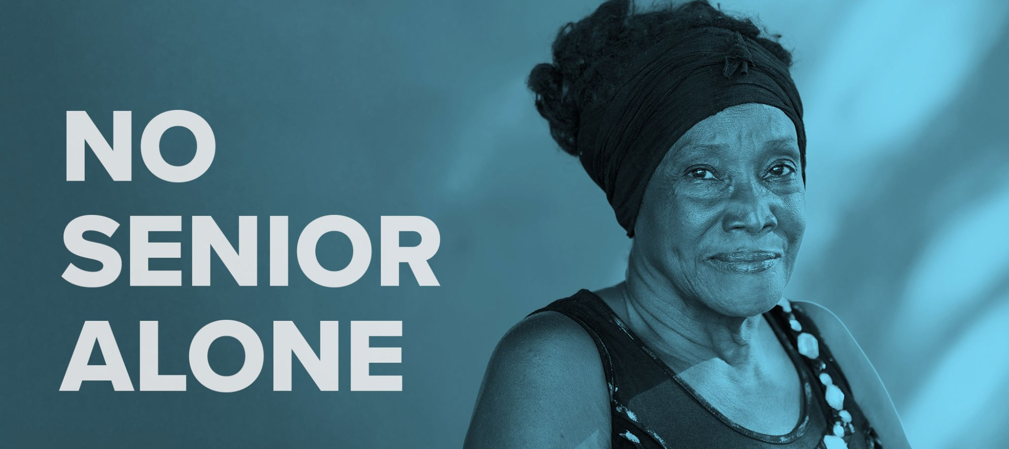 "Words ""No Senior Alone"" overlayed on an image of an older Black woman looking at the camera"