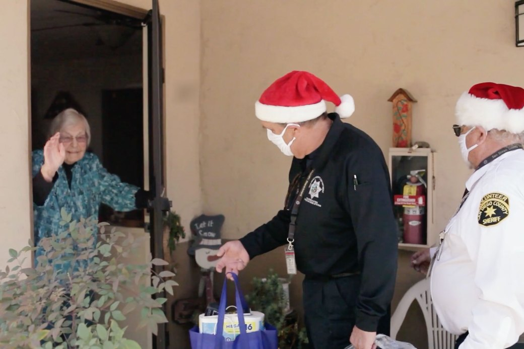 Volunteers from the Sheriff's YANA program deliver holiday gifts to isolated seniors