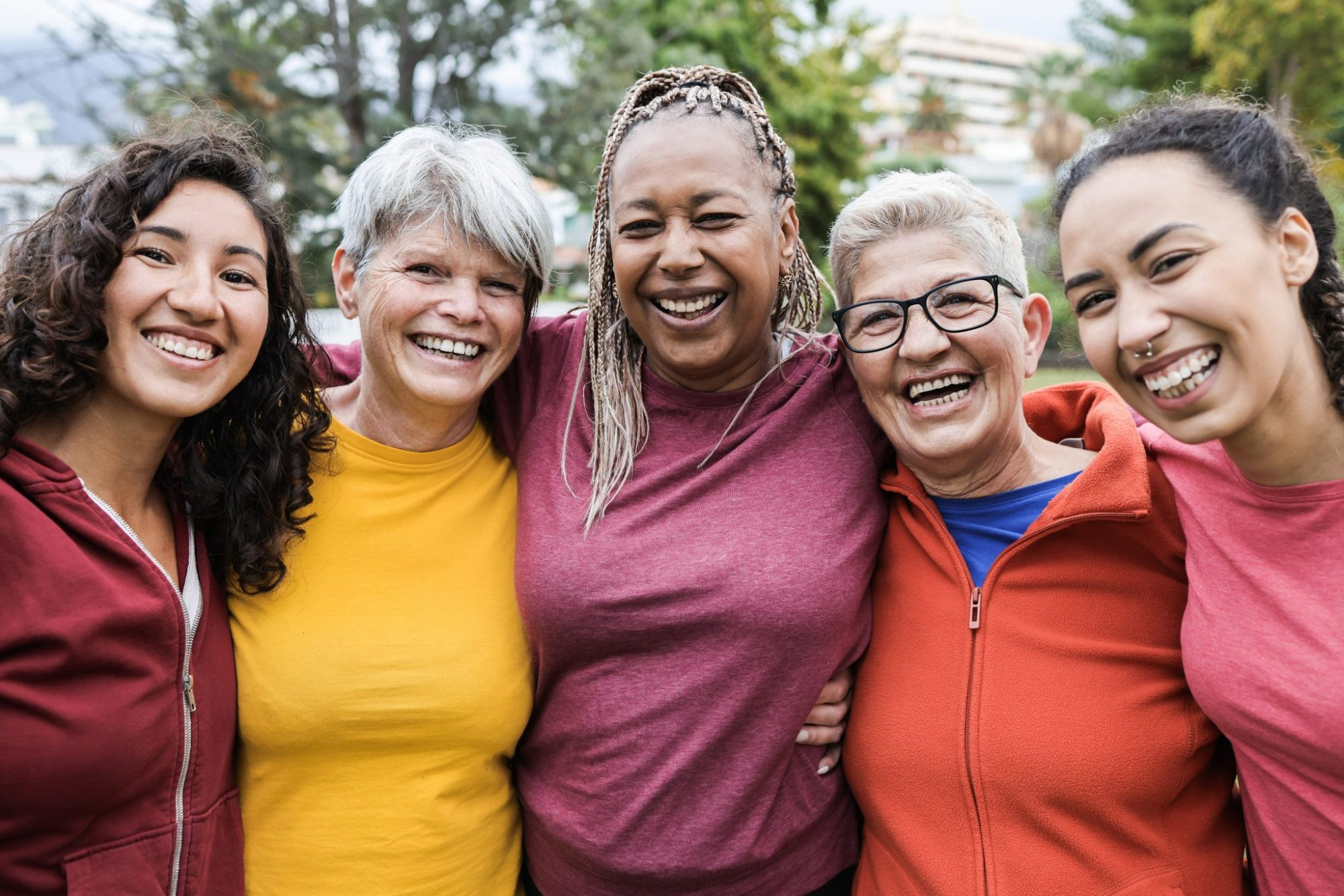 a multi-generational group of happy, smiling women