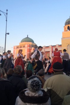 Hungarian Folk dancers dominate the stage during the daytime, as the parade continues throughout the town.