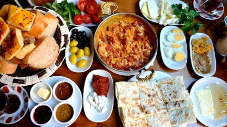 Kahvaltı is the traditional Turkish breakfast. It consists of a spread of cucumber, tomatoes, olives, different types of cheeses and cold meats, hard-boiled eggs, yogurt, jams, butter and honey accompanied by bread or simit (similar to a sesame seed bagel)...