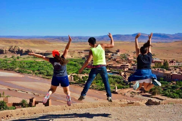 The three amigos jumping in open air in Kasbah Ait Ben Haddou, Morocco.