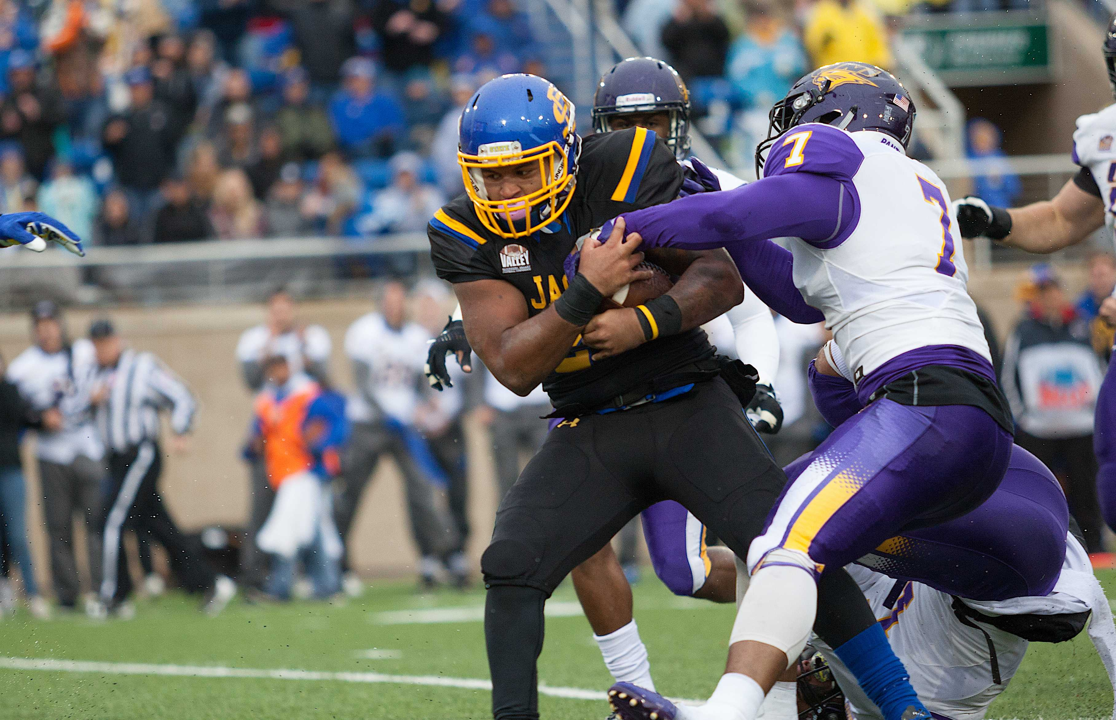 THIEN NGUYEN  Sophomore Mikey Daniel (26) rushes 21 yards for a first down during the game against UNI Oct. 14. The Jacks will face No. 14 Western Illinois Saturday in Macomb, Illinois.