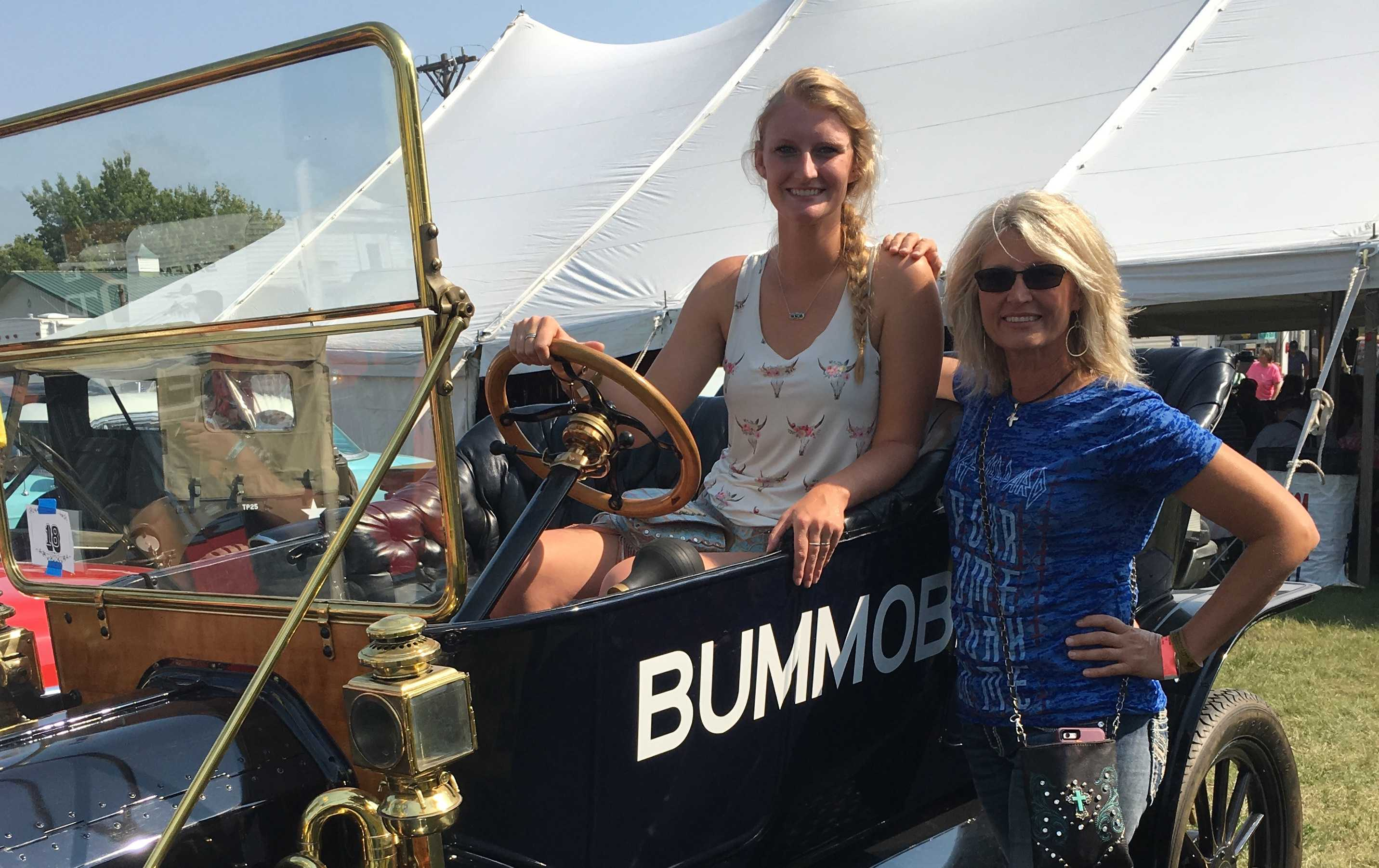 SUBMITTED PHOTO Mariah Kessler and her mother, Colette, pose with the Bummobile at the 2017 South Dakota State Fair Car Show.