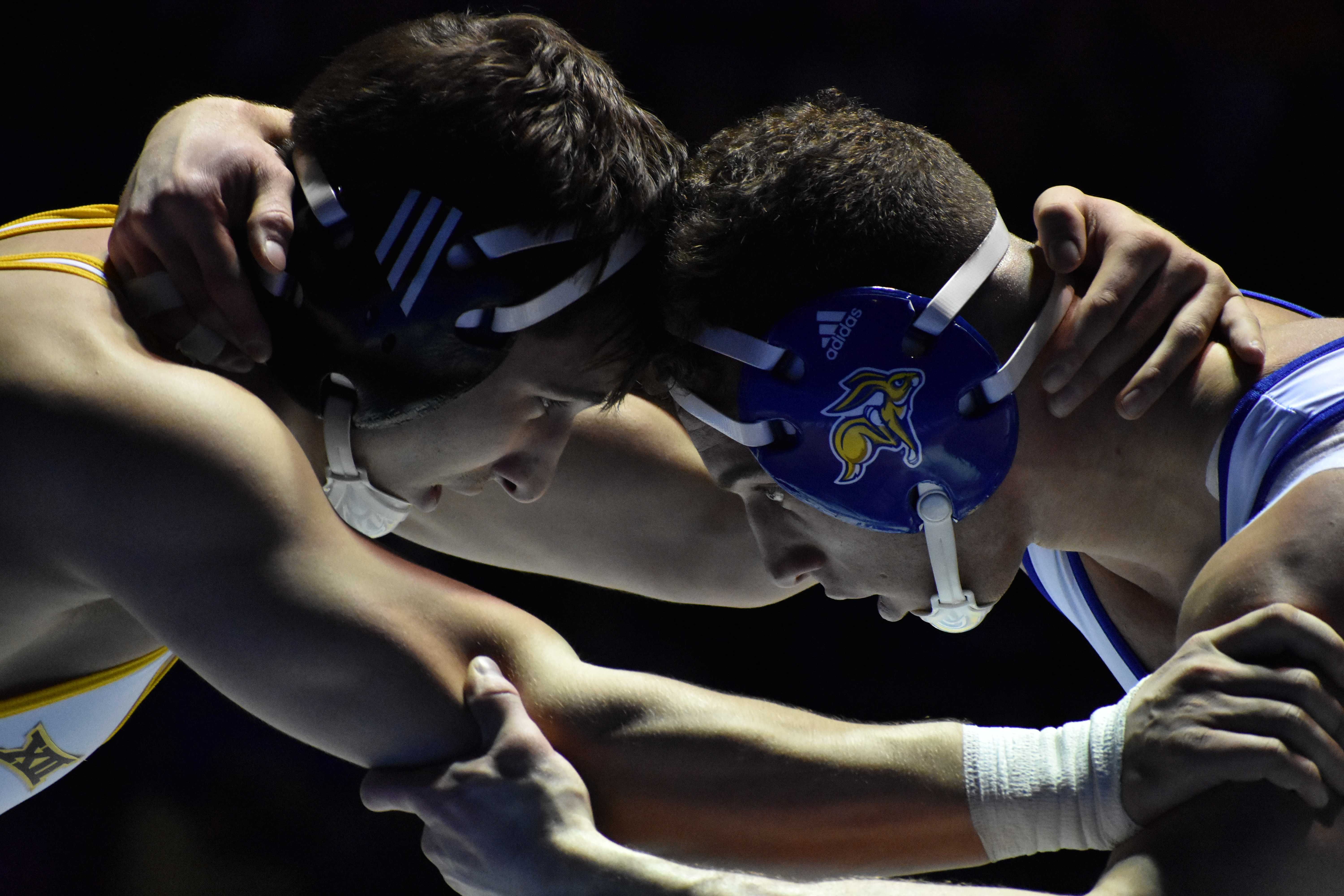 ABBY FULLENKAMP Sophomore Martin Mueller wrestles Chaz Polson during the 184-pound bout Jan. 18. Mueller defeated Polson by fall 2:49. The Jacks host Iowa State at 2pm Sunday, Feb. 4 in Frost Arena.