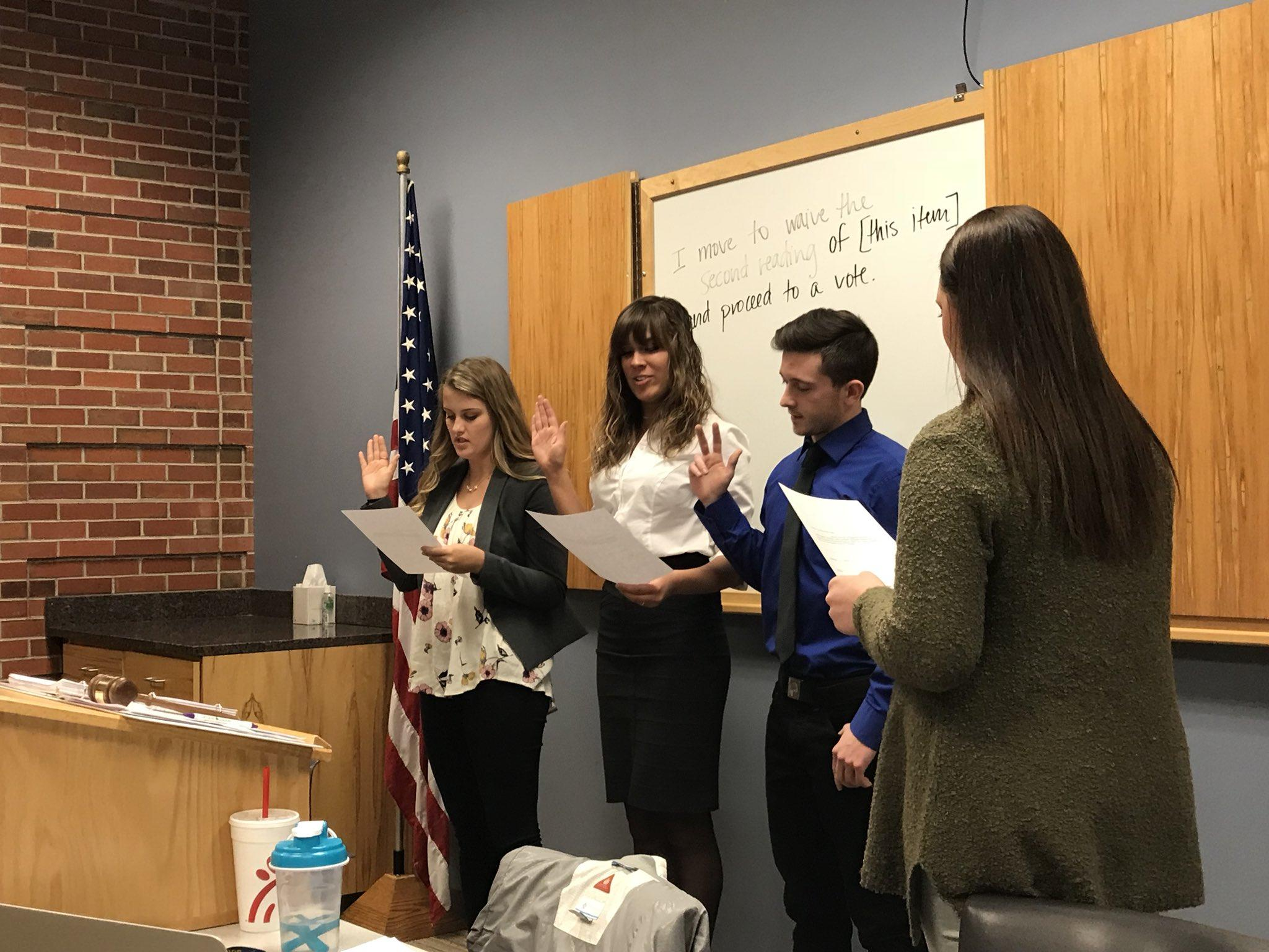 EMILY DE WAARD (Left to right) Allison Pauley, Baylee Dittman and Ryan Sailors swearing in as At-Large senators at the Jan. 29 Students' Association meeting.