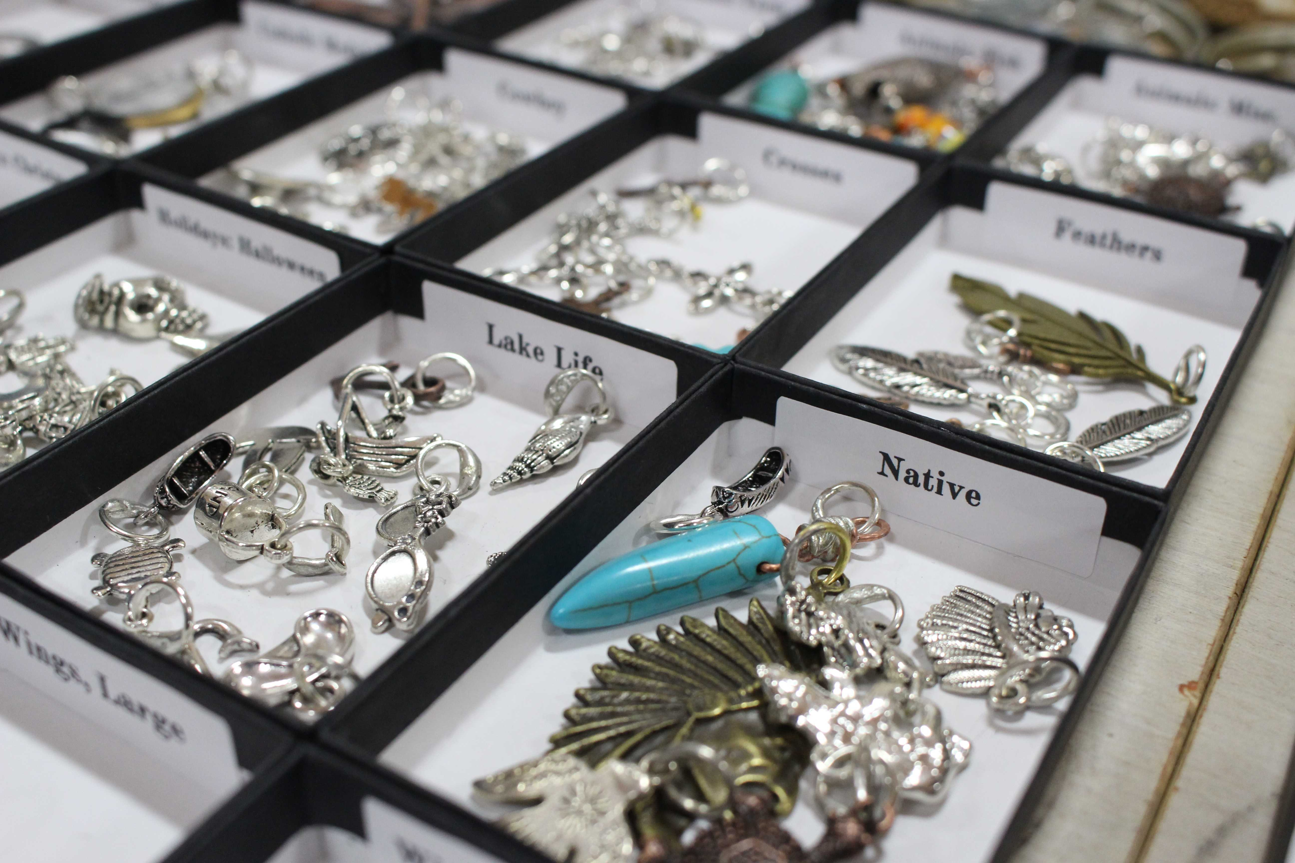 KELLY MITCHELL Shelleen Weeks, owner of Do-OverS!, makes homemade charms from recycled metals and sold them during the Brookings Pop-Up Market Friday, Feb. 2 and Saturday, Feb. 3 at the Brookings Recreation Center. The Brookings Pop-Up Market hosted several booths for entrepeneurs from the community.