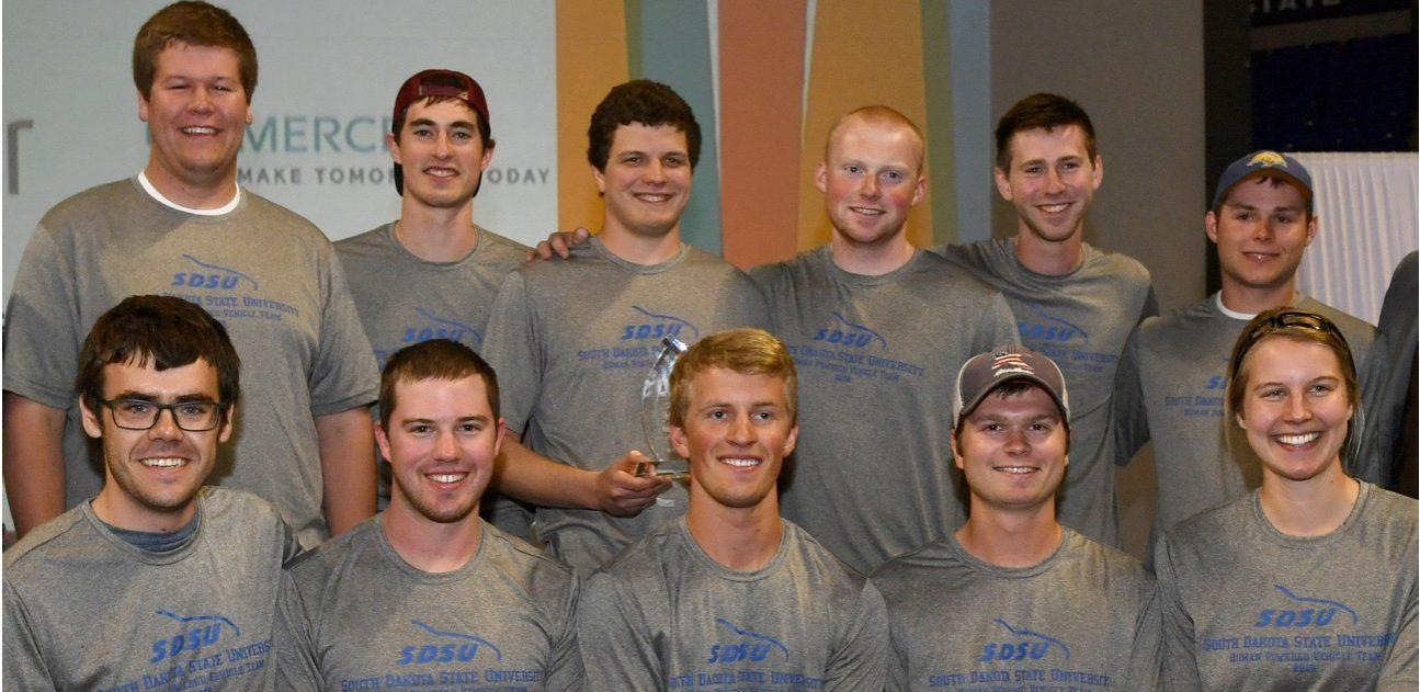 SUBMITTED SDSU's Human Powered Vehicle team poses with its first-place check and trophy after winning the East regional contest April 15 in State College, Pennsylvania. Three weeks earlier, the team  won the West regional. Pictured, back row, from left, are Brennen Walley, Cody Reed, Josh Zwinger, Nick LaFave, Sam Reski and Jason Scheffert. Front row: Alex Gray, Jake Ostby, Eric Looyenga, Cole Sullivan and Claire Eggleston.