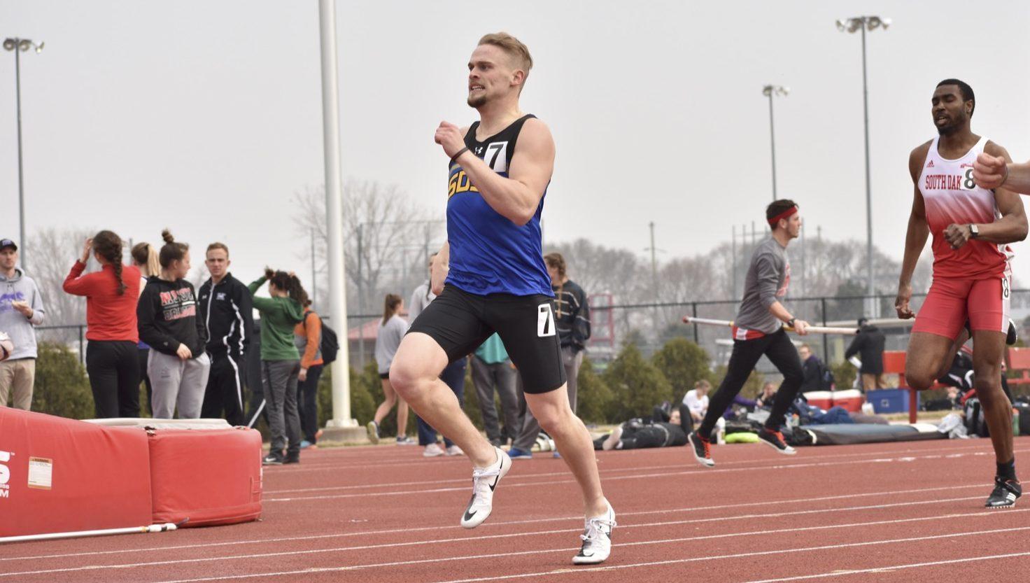 ABBY FULLENKAMP Junior Skyler Monaghan runs in the second heat of the men's 400 meter dash during the South Dakota Invitational meet April 10 at the University of South Dakota in Vermillion.