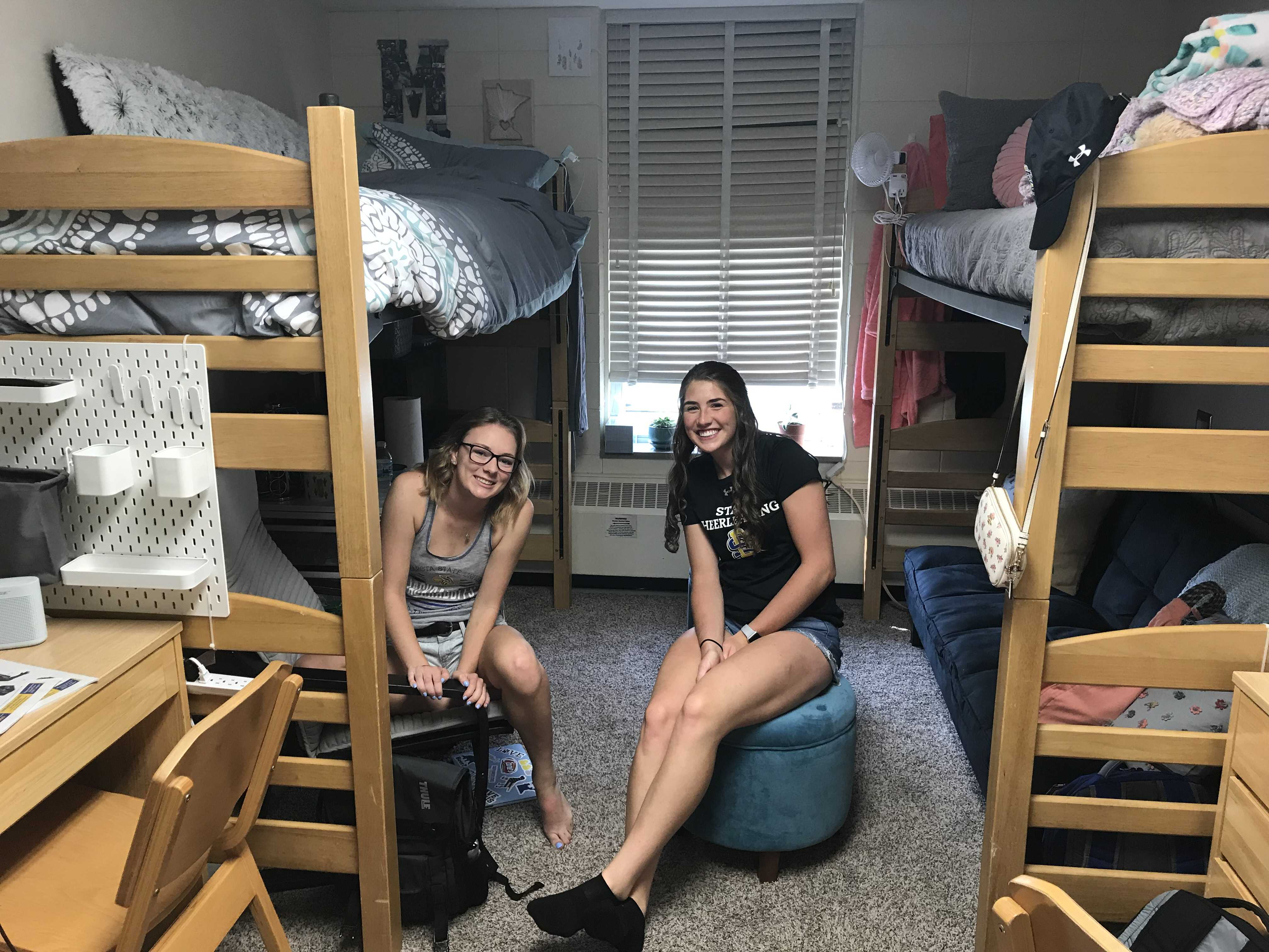 Molly Lange and her roommate Hanna Siemonsma sit in their room in Young Hall.