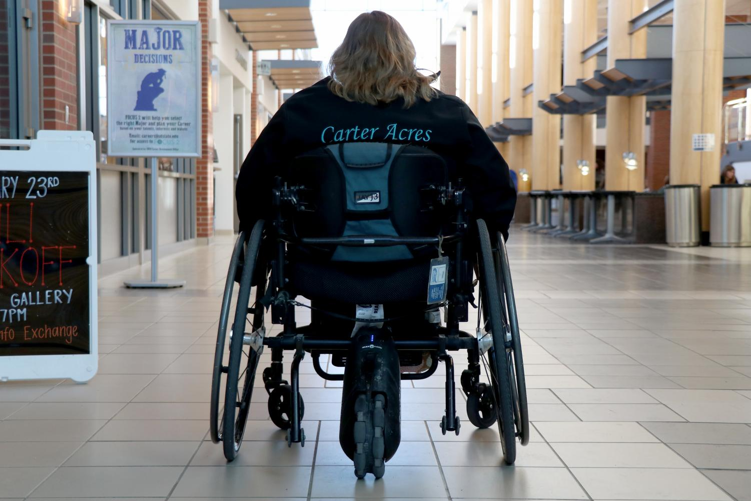 Abby Donkers, a senior agriculture leadership major, uses a wheelchair and is raising awareness about accessibility on SDSU's campus.