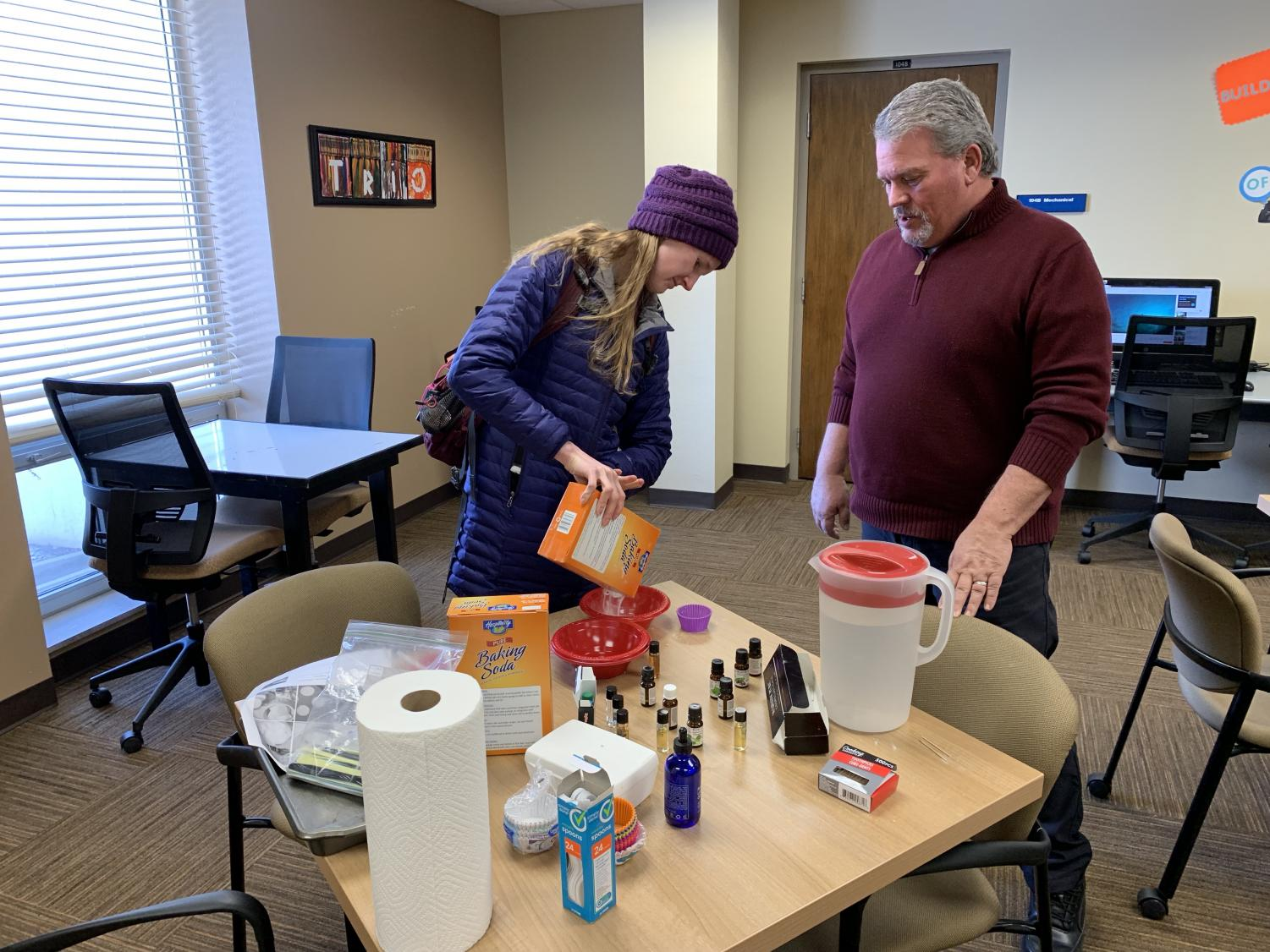 Kristina Rice, junior family and consumer sciences education major, participates in making a bath bomb during TRIO National Relaxation Day event with help from TRIO Program Director, Jeff Vostad