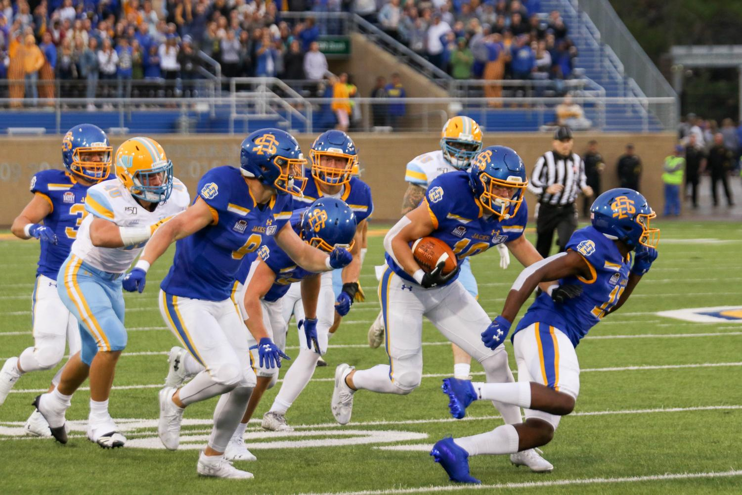 South Dakota State redshirt freshman and Madison, South Dakota, native Jaxon Janke (10, with football) runs through would-be tacklers with the help of several escorts, including twin brother Jadon (9), on a 77-yard punt return touchdown Sept. 7 against Long Island. After appearing in just seven combined games in 2018, Jadon and Jaxon, who play wide receiver, are seeing regular playing time in 2019.