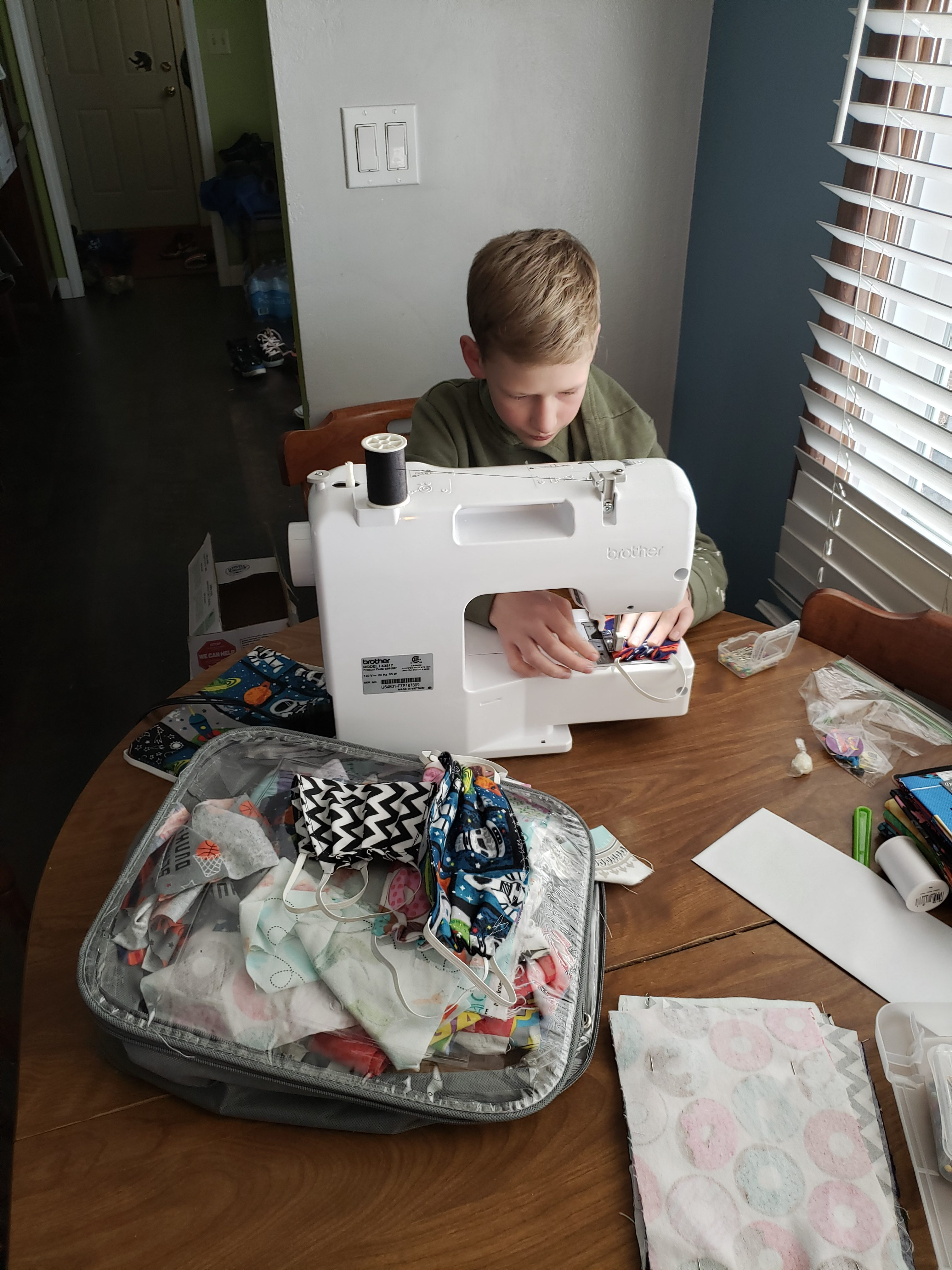 Colin at the sewing machine