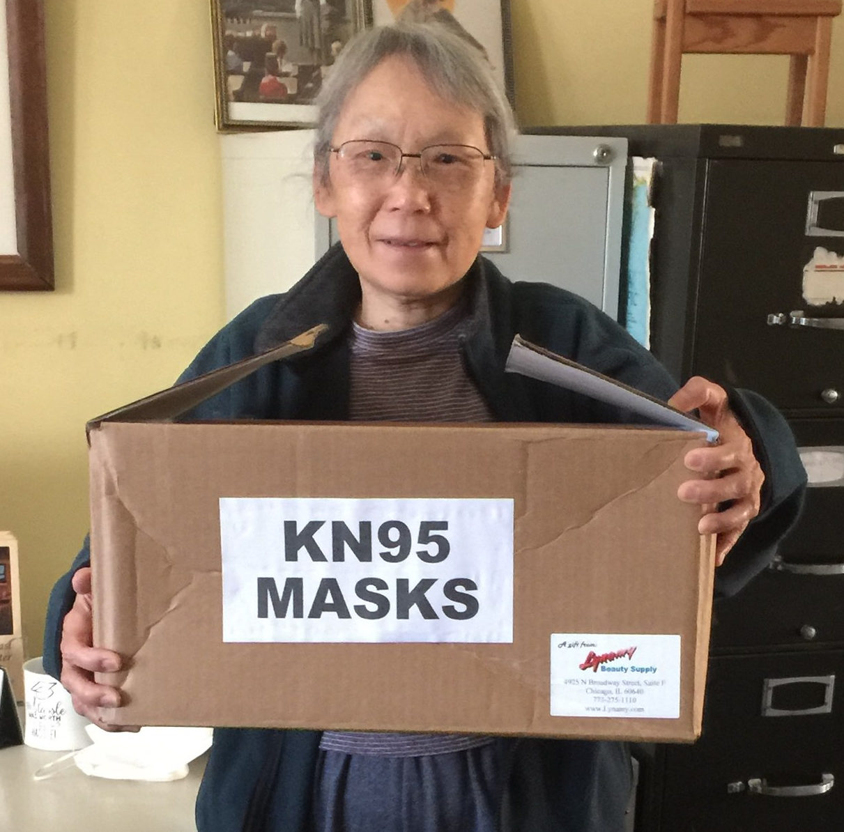 San O hold box of masks donated ny LynAmy Beauty Supply