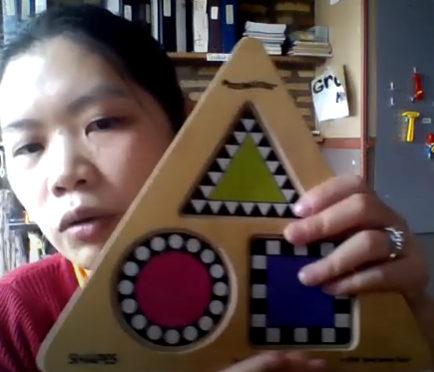teacher shows shapes