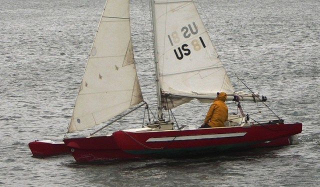 Peter Marsh on the 21' trimaran he designed and built on a windy day on the Columbia