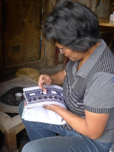 An everyday scene of my village hostess drawing batik. Photo courtesy of Yu Luo.