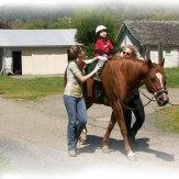 TRAIL Program child on horse being led