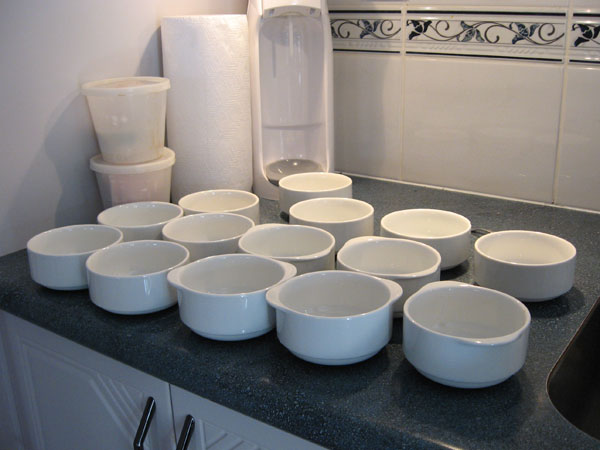 14 food bowls ready to be filled