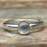 Shop: A silver ring with white a seaglass stone.