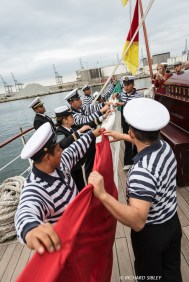 Stowing the flag onboard the Mexican Barque, Cuauhtemoc
