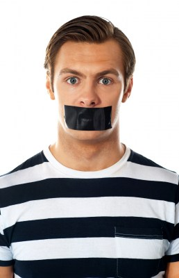 Male with tape covered over mouth. Nonverbal first impression