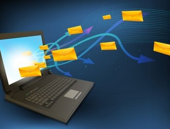 Laptop with emails pouring into it. How to increase email newsletter signups by Seafoam Media
