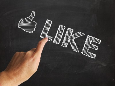 """Hand touching the word """"Like"""". Social media facts Seafoam Media St Louis"""