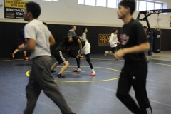 YOKOSUKA, Japan (Jan. 31, 2017) – Fleet Activities (FLEACT) Yokosuka's Nile C. Kinnick High School wrestling team prepares for the Japan Finals, the last home event for the Red Devils scheduled for 9 a.m. Saturday, Feb. 4. FLEACT Yokosuka provides, maintains, and operates base facilities and services in support of 7th Fleet's forward-deployed naval forces, 83 tenant commands, and 24,000 military and civilian personnel. (Photo by Kristina Mullis/170131-N-LV456-005 Released by FLEACT Yokosuka Public Affairs Office)