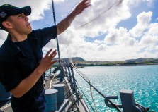 170301-N-FV739-024 APRA HARBOR, GUAM (March 1, 2017) Seaman Erik Renteri, from Dallas, Texas, throws a line on the pier from the forecastle of Arleigh Burke-class guided-missile destroyer USS Barry (DDG 52) during sea and anchor detail. Barry is on patrol in waters south of Japan supporting security and stability in the Indo-Asia-Pacific region. (U.S. Navy photo by Mass Communication Specialist 3rd Class Christopher A. Veloicaza/Released)