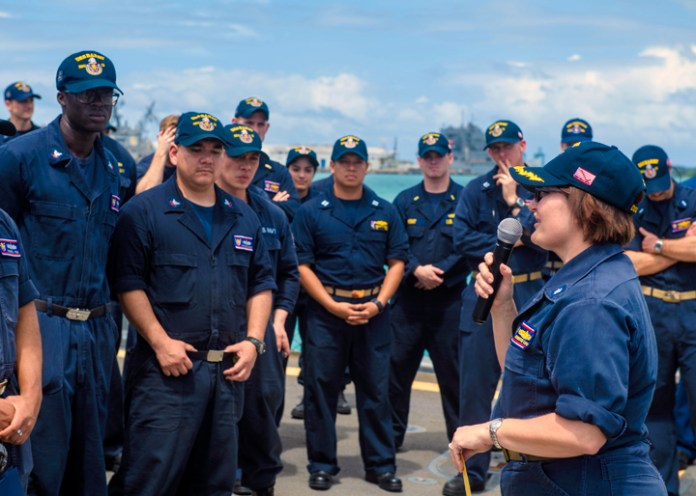 170301-N-FV739-093 APRA HARBOR, GUAM (March 1, 2017) Cmdr. Jennifer Eaton, commanding officer, addresses Sailors during an all-hands call on the flight deck of Arleigh Burke-class guided-missile destroyer USS Barry (DDG 52). Barry is on patrol in waters south of Japan supporting security and stability in the Indo-Asia-Pacific region. (U.S. Navy photo by Mass Communication Specialist 3rd Class Christopher A. Veloicaza/Released)