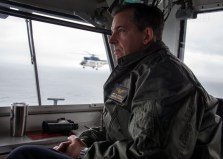 170510-N-PF593-025 WATERS SOUTH OF JAPAN (May 10, 2017) Capt. Buzz Donnelly, commanding officer of the Navy's forward deployed aircraft carrier, USS Ronald Reagan (CVN 76), observes flight operations from the navigation bridge during a vertical replenishment-at-sea. SA-330J Pumas, assigned to Military Sealift Command dry cargo and ammunition ship, USNS Charles Drew (T-AKE 10), transferred ordnance to Ronald Reagan's flight deck. Ronald Reagan, the flagship of Carrier Strike Group 5, provides a combat-ready force that protects and defends the collective maritime interests of its allies and partners in the Indo-Asia-Pacific region. (U.S. Navy photo by Mass Communication Specialist 2nd Class Jamal McNeill/Released)