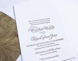 gold letterpress wedding invitation with blind monogram impression