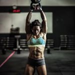 crossfit garage gym girl kettlebell