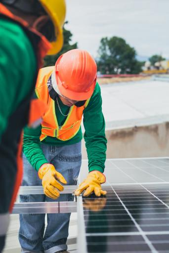 Image of solar panels being installed that describe new modern innovation that is needed to be a social entrepreneur.