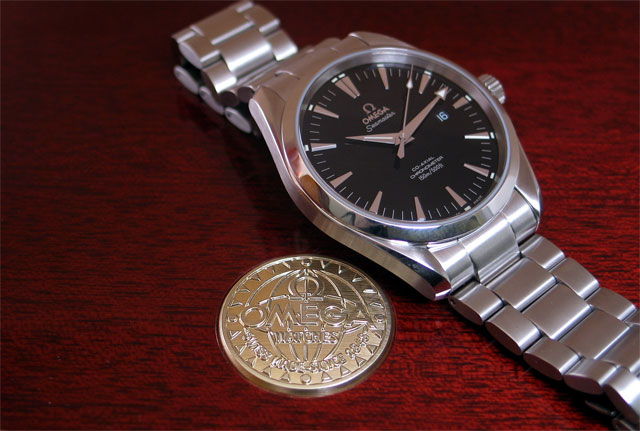 As stated previously, the dial color was a tough choice, but in the end the  high gloss, ultra-black dial won me over. Absent is the signature Seamaster  wave ...